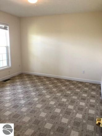 Rent this 3 bed apartment on 2212 Tyler Hills Drive in Grand Traverse County, MI 49685
