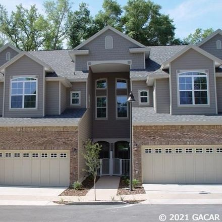 Rent this 3 bed townhouse on NW 34th St in Gainesville, FL