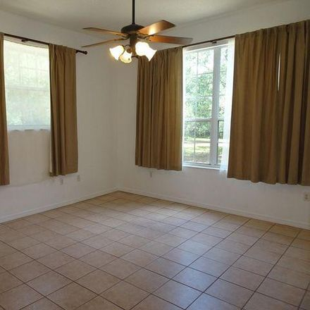 Rent this 4 bed house on 3282 Palomino Road in Sherman Park, FL 32934