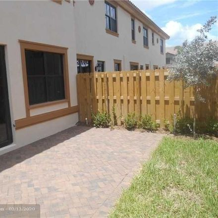 Rent this 4 bed townhouse on 9631 Watercrest Isle in Parkland, FL 33076