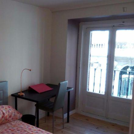 Rent this 6 bed room on Calle de Arrieta in 13, 28013 Madrid