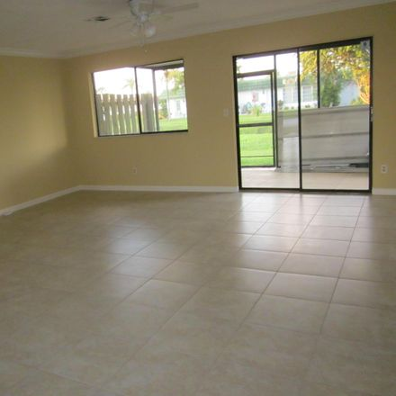 Rent this 3 bed townhouse on 5806 Channel Drive in Greenacres, FL 33463
