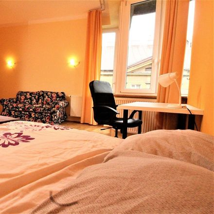 Rent this 3 bed room on Henryka Sienkiewicza 9 in 30-033 Krakow, Poland