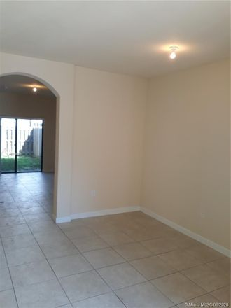 Rent this 3 bed townhouse on 3209 SE 5th Street in Homestead, FL 33033