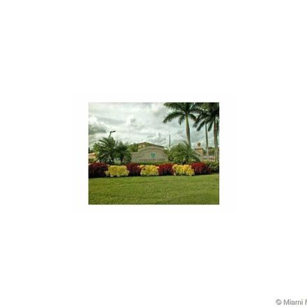 Rent this 3 bed condo on 5065 Wiles Road in Coconut Creek, FL 33073