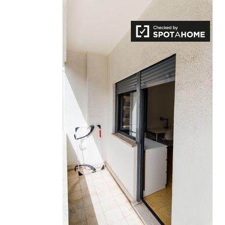 Rent this 11 bed apartment on Ecoilha Subterrânea in Avenida Miguel Bombarda, Lisbon