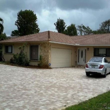 Rent this 4 bed house on NW 3rd Ct in Pompano Beach, FL