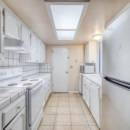 Rent this 3 bed condo on 1327 West Norwich Avenue in Fresno, CA 93705