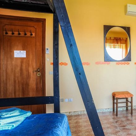 Rent this 4 bed room on Via Giuseppe Fumagalli in 00168 Rome RM, Italy