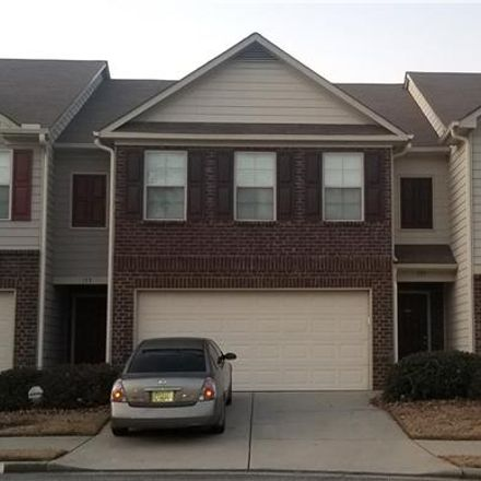 Rent this 3 bed townhouse on Oakland Hills Way in Lawrenceville, GA