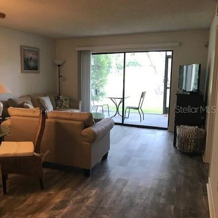Rent this 2 bed condo on Longwater Chase in The Meadows, FL 34235