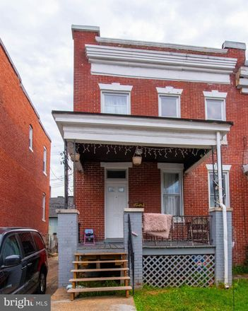 Rent this 3 bed townhouse on 607 Linnard Street in Baltimore, MD 21229