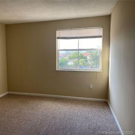 Rent this 2 bed condo on 6284 Northwest 186th Street in Country Club, FL 33015