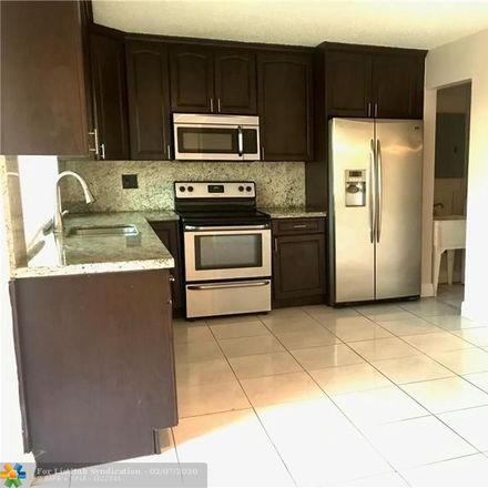 Rent this 4 bed house on 6773 Ixora Drive in Miramar, FL 33023