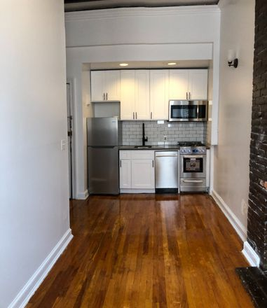 Rent this 2 bed townhouse on 105 Christopher Street in New York, NY 10014
