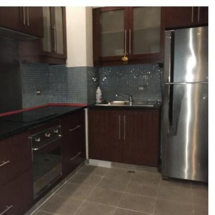 Rent this 2 bed condo on Ayala Avenue in Makati, 1226