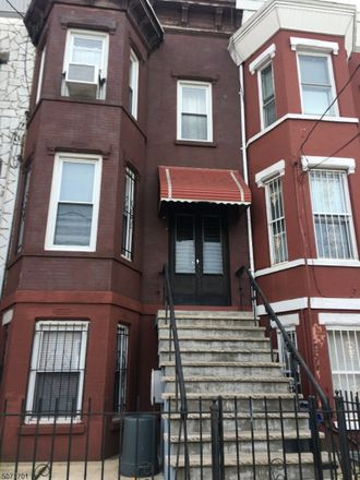 Rent this 3 bed townhouse on 61 Atlantic Street in Jersey City, NJ 07304