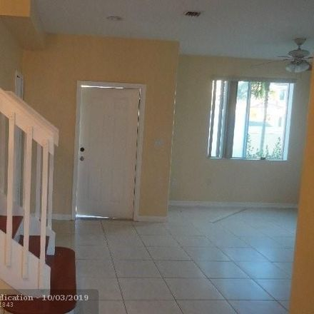 Rent this 3 bed townhouse on 1425 Southeast 24th Court in Homestead, FL 33035