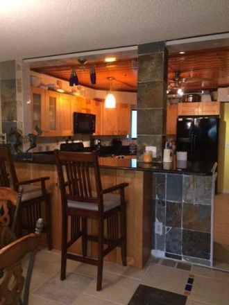 Rent this 2 bed condo on Uno Lago Drive in Juno Beach, FL 33408