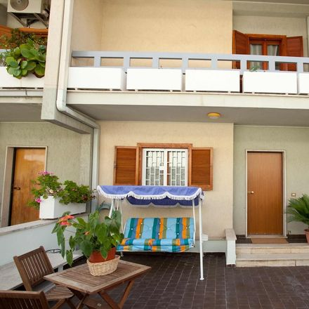 Rent this 3 bed room on Via Santena in 28, 00166 Roma RM