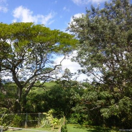 Rent this 3 bed house on Halawa Dr in Aiea, HI