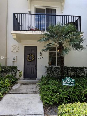 Rent this 2 bed townhouse on 174 Greenwich Circle in Jupiter, FL 33458