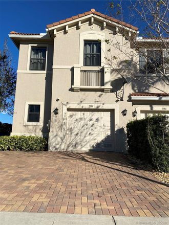 Rent this 3 bed townhouse on NW 11th Ave in Pompano Beach, FL
