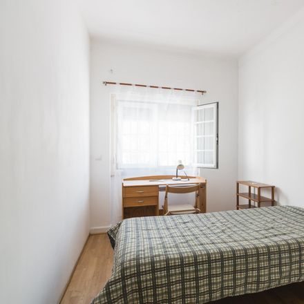 Rent this 4 bed room on Rua 30 in 1300-663 Lisbon, Portugal
