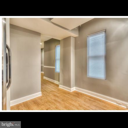 Rent this 2 bed townhouse on E Fayette St in Baltimore, MD