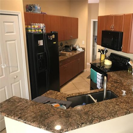 Rent this 3 bed townhouse on SW 122nd Pl in Miami, FL