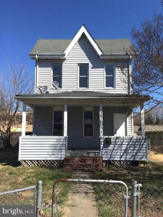 Rent this 4 bed house on 404 Washburn Avenue in Baltimore, MD 21225