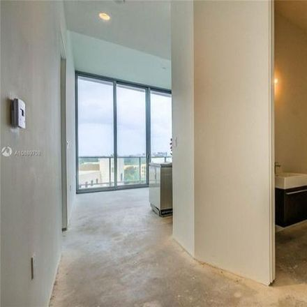 Rent this 2 bed condo on Grove at Grand Bay in 2669 South Bayshore Drive, Miami