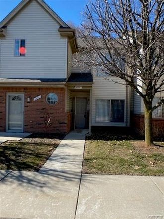 Rent this 2 bed condo on 41031 Rose Lane in Clinton Township, MI 48036