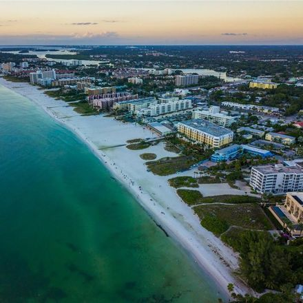 Rent this 2 bed condo on Sarasea Circle in Point O'Rocks, FL 34242