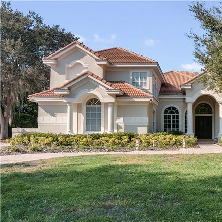 Rent this 5 bed house on 8700 Southern Breeze Dr in Orlando, FL