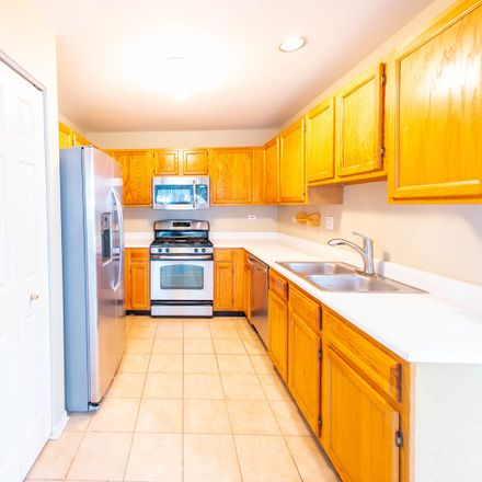 Rent this 3 bed townhouse on 1524 East Chivalry Court in Palatine, IL 60074