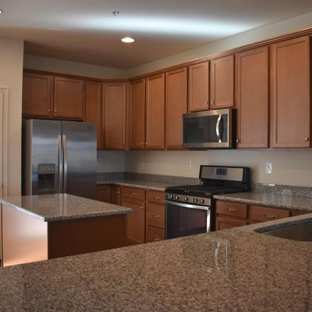 Rent this 3 bed townhouse on Adelaide Lane in Owings Mills, MD 21133