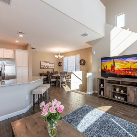 Rent this 4 bed townhouse on 240 West Juniper Avenue in Gilbert, AZ 85233