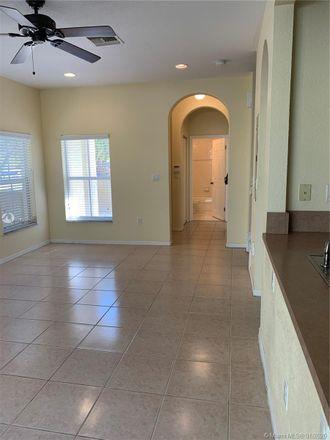 Rent this 3 bed loft on 3347 Merrick Lane in Margate, FL 33063