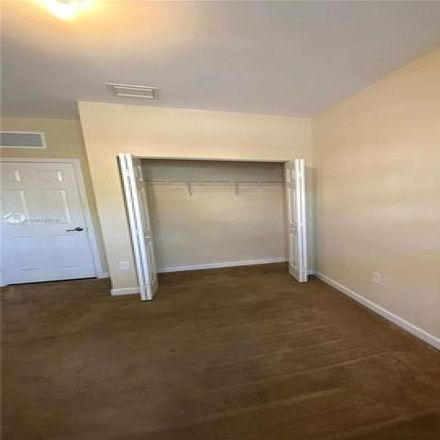 Rent this 4 bed house on 9401 Southwest 171st Avenue in The Hammocks, FL 33196