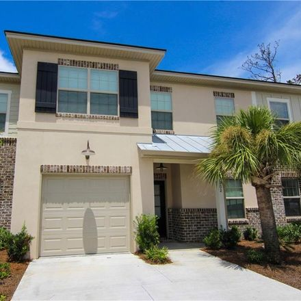 Rent this 3 bed townhouse on Island Dr in Saint Simons Island, GA