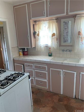 Rent this 4 bed house on 7842 La Salle Avenue in Los Angeles, CA 90047
