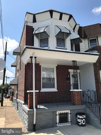 Rent this 3 bed townhouse on 5019 Tulip Street in Philadelphia, PA 19124