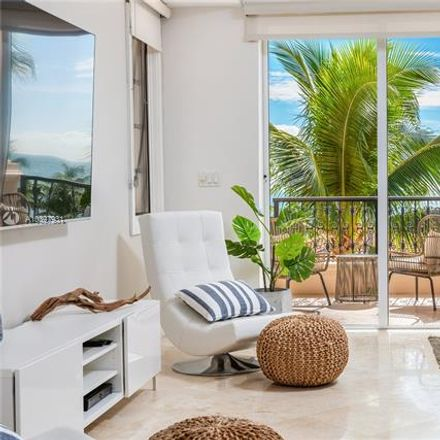 Rent this 3 bed condo on Fisher Island