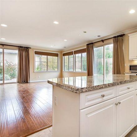 Rent this 4 bed condo on 115 Desert Bloom in Irvine, CA 92618