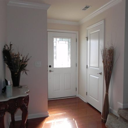 Rent this 4 bed townhouse on Pemberwich Place in Cary, NC 27560-9533