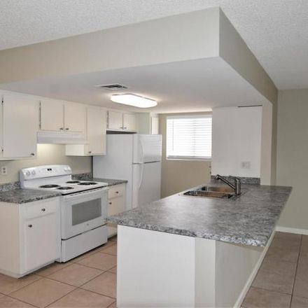 Rent this 2 bed condo on Consoliated Canal Path in Mesa, AZ 85203