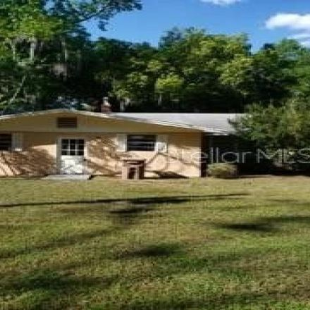 Rent this 3 bed house on 1299 Northeast 2nd Place in Ocala, FL 34470