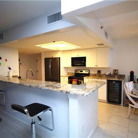 Rent this 2 bed condo on 6585 Nicholas Blvd in Naples, FL