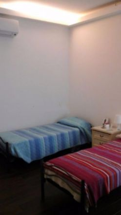 Rent this 2 bed room on Pam express in Viale Giulio Agricola, 00174 Rome RM